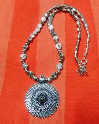 metal necklace set images Buy fancy metal necklace set with textured design jpeg