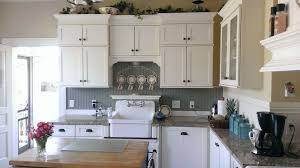 wainscoting backsplash kitchen country kitchen with wood counters flat panel cabinets in tacoma