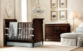 amazing baby nursery with chandelier and wooden sleigh crib