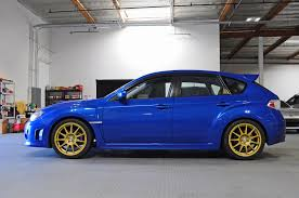 blue subaru gold rims media subaru parts and accessories mann engineering