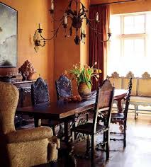tuscan style dining room washed wall color and wrought iron