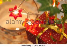 view of illuminated star shaped christmas lights on tree stock