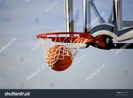 action shot basketball going through basketball stock photo
