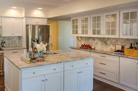 interior cozy kitchen design with herringbone backsplash and