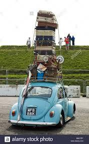 volkswagen santa volkswagen beetle overloaded with suitcases at the big bang show