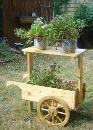 Wooden Wheelbarrow Planter by Wooden Wheelbarrow Planter Decorative Display Cart