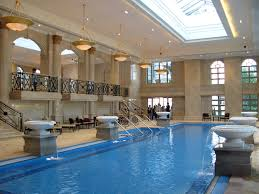 classy hotel indoor swimming pool design with lengthwise pool with
