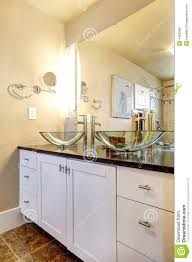 bathroom vanity cabinet with glass vessel sinks stock photo