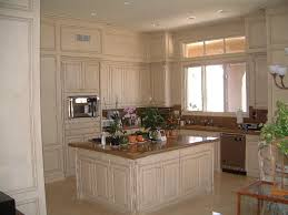 Mediterranean Kitchen Cabinets - kitchen cabinets with cream and coffee glazed finish