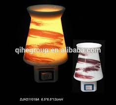plug in candle night light qihe factory ceramic plug in candle warmer fragrance oil scent wax