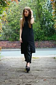 style trunk midi dress over leather pants
