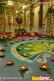 colorful rangoli with diyas arrangement on ganesh chaturthi