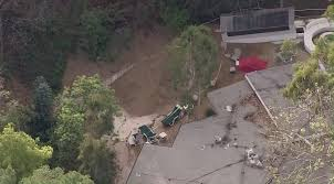 water line break causes mud to slide into backyard of beverly