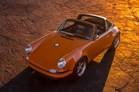 orange porsche 911 convertible a lovely pair of porsche 911s by singer showed up at pebble
