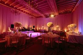 uplighting wedding 10 wedding reception spaces featuring soft pink uplighting