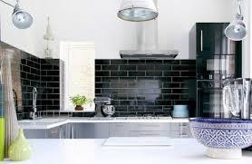 black subway tile backsplash with white cabinets backsplash