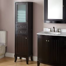 linen cabinet with glass doors bathroom ceiling to floor brown varnished mahogany wood bathroom