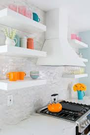 dream kitchen remodel from planning to completion thomasville vent hood mosaic backsplash and floating shelves in newly remodeled kitchen
