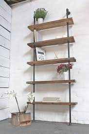 jessica reclaimed waxed scaffolding boards and dark steel pipe
