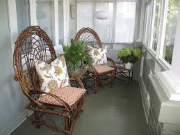 cool small glass enclosed patio design with unique branch chair