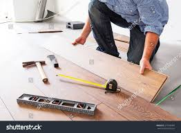 Laminated Timber Floor Man Installing New Laminated Wooden Floor Stock Photo 215706484