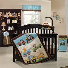 baby boy nursery room with wooden furniture and animal crib