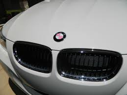 add a pink touch to your bmw with this decal emblem overlay kit