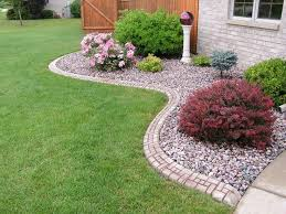 flower beds with rocks replace front yard flower beds with river