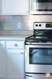 best images about kitchen ideas inspiration pinterest the peel and stick decorative metal tilewas key making this backsplash installation