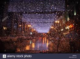 white christmas lights sheets of white christmas lights strung across a city on a