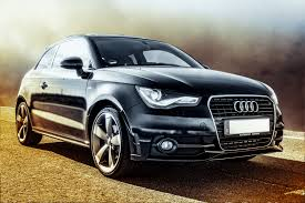 black audi car black audi coupe on brown road free stock photo