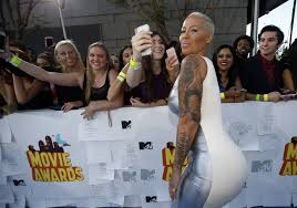 amber rose pink jeep amber rose flashes assets in low cut dress bonds with son sebastian