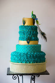 stunning turquoise and gold peacock wedding cake with gold cake