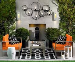 stunning outdoor living room with orange sofa outdoor living