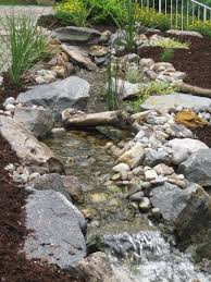 best 25 garden stream ideas on pinterest modern pond small