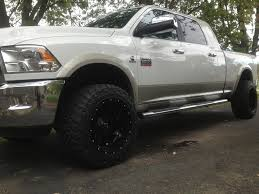 dodge ram with black rims white truck with black rims any pics would be dodge diesel
