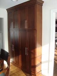 Kitchen Armoire Cabinets Pantrieswhen We Take Down Part The Wall Tall Kitchen Armoire