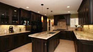 dark cabinets and countertops block paving floor light wooden