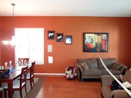 orange wall paint warm terracotta walls dark tile floor dark wood