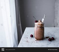 milkshake photography a chocolate milkshake in a mason jar stock photo offset