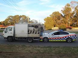 police truck police detain man after truck rams into police car community