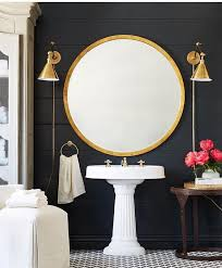 black bathroom mirrors gorgeous gold round mirror and brass wall sconces in this modern
