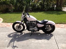883 sportster custom paint pearl with a tint of pink motorcycle