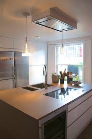 the island has a double sink a dishwasher an induction hob a