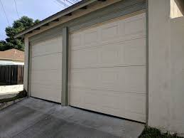 advice for converting two single garage doors into one double door
