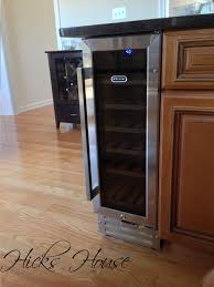 particleboard raised door pacaya kitchen island with wine fridge