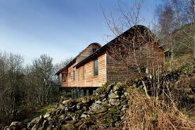 homes built into hillside how to build on a sloping site homebuilding renovating