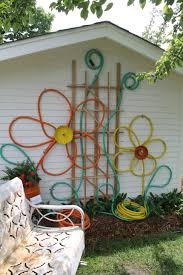 outdoor living colorful hoses flowers outdoor wall decor near