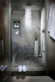 loft bathroom ideas concrete and pebble shower in a loft bathroom via delancey