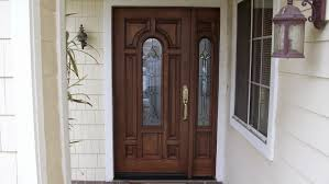 shabby dark varnished teak wood front door with sidelights with